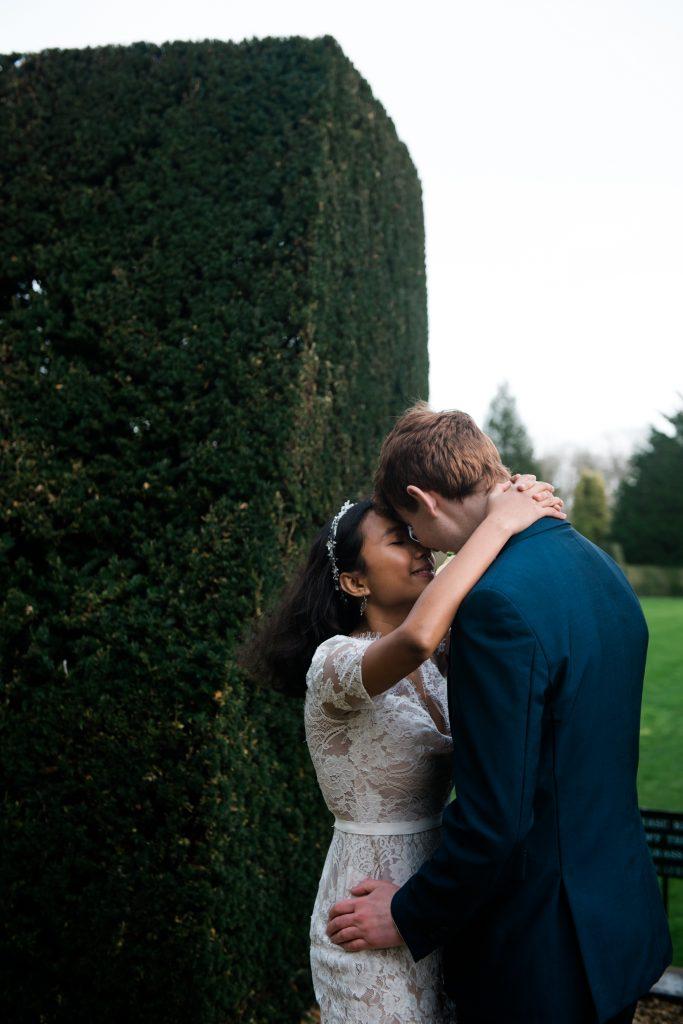 romantic photoshoot with wedding couple outside Madingley Hall in Cambridge