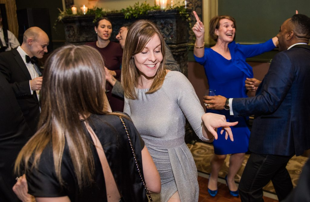 guests capturing candidly enjoying a dance. authentic wedding photographer