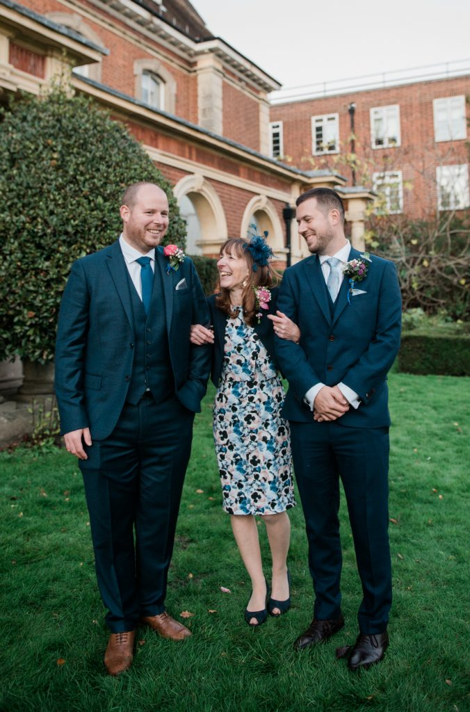 groom, best man and mother enjoying themselves at covid micro wedding