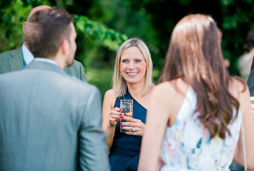 candid shot of wedding guest smiling