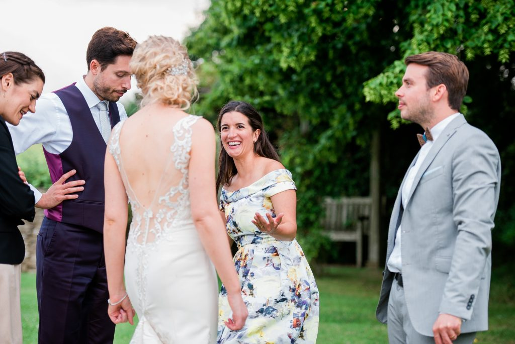 candid shot of wedding guests enjoying themselves