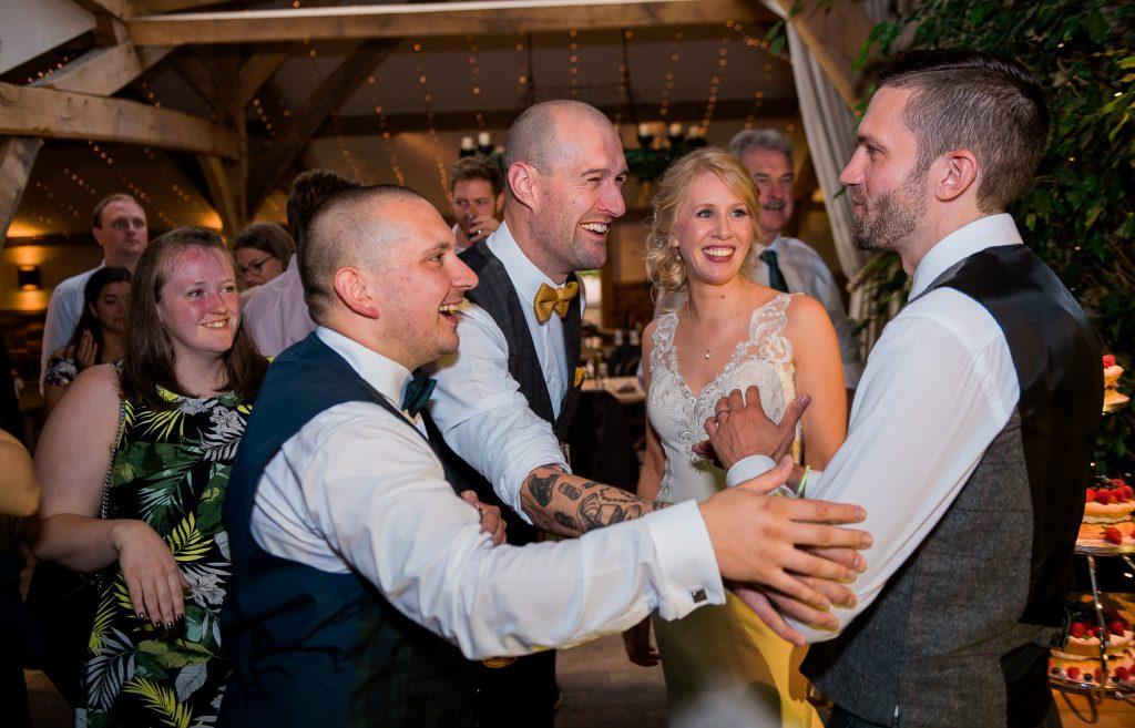 bride's friends teasing the groom